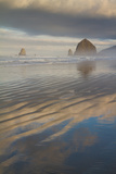 Haystack Rock, the Needles, and Reflections of Clouds at Sunrise Photographic Print by Greg Winston