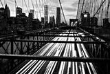 The Manhattan Skyline Rises Above Traffic on the Brooklyn Bridge Photographic Print by Kike Calvo