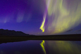 A Northern Lights Display During a Geomagnetic Solar Storm on the South Coast of Iceland Photographic Print by Mike Theiss