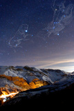 Orion, and Canis Major with Sirius, over the Alborz Mountains. Car Lights Glow in the Haraz Valley Photographic Print by Babak Tafreshi