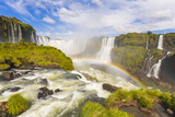 A Rainbow at Iguazu Waterfalls on the Border of Argentina and Brazil in South America Photographic Print by Mike Theiss