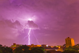 A Lightning Bolt Striking Down in the City of Asuncion, Paraguay During an Intense Lightning Storm Photographic Print by Mike Theiss