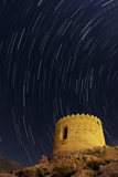 Time-Exposure of Star Trails Above an Ancient Watchtower in Niasar Village Photographic Print by Babak Tafreshi