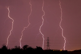 Multiple Lightning Strikes During an Intense Lightning Storm Pounds Dallas Photographic Print by Mike Theiss