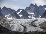 A Scenic View of a Glacier and Jagged Mountain Peaks Cradling Nests of Snow Photographic Print by Jay Dickman