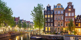 Houses Along Canal at Dusk at Intersection of Herengracht and Brouwersgracht, Amsterdam Photographic Print by Green Light Collection