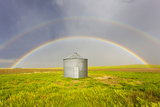 A Double Rainbow, Perfectly Centered over a Grain Silo and Wheat Field after a Thunderstorm Passes Photographic Print by Mike Theiss