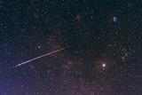 A Bright Meteor Shoots across the Sky Near Jupiter Photographic Print by Babak Tafreshi