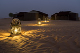 Lanterns Illuminate a Path Toward Tents in the Erg Chebbi Sand Dunes Photographic Print by Ira Block