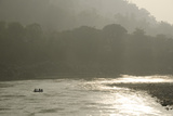 A Group of People White Water Rafting at Sunset Down the Ganges River Impressão fotográfica por Pete McBride