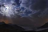 Rays of Moonlight and Passing Clouds over a Valley in the Alborz Mountains Photographic Print by Babak Tafreshi