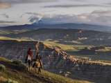 Wranglers on Horses Looking over the Dubois Badlands and Ramshorn Mountain, in Wind River Valley Photographic Print by Jay Dickman