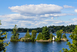 Small Island with a Cottage and a Lighthouse on Lake Muskoka, Ontario, Canada Photographic Print by Green Light Collection