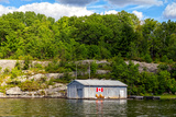 Old Metal Boathouse with Wooden Chairs, Lake Muskoka, Ontario, Canada Photographic Print by Green Light Collection