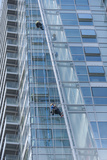 Window Cleaners on the Side of a Tall Building in London, England Photographic Print by Jeff Mauritzen