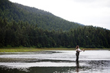 A Woman, Using a Fly Rod, Fishes for Salmon Photographic Print by Michael Hanson