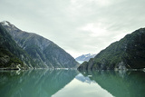 Magnificent Cliffs Reflect in the Aqua Green Waters of Tracy Arm Fjord Photographic Print by Jonathan Kingston