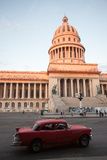A Classic American Car Drives Past the El Capitolio Building in Downtown Havana Photographic Print by Eric Kruszewski
