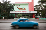 In Havana, a View of a Theater and Classic American Car Photographic Print by Eric Kruszewski
