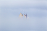Low-Lying Fog Hides a Wooden Masted Schooner in Casco Bay Photographic Print by Robbie George