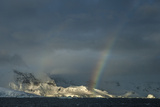 A Rainbow Arches over the Nuemayer Channel Off the Antarctic Peninsula Photographic Print by Cristina Mittermeier
