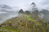 Tourists Visit the Pre-Columbian Inca Ruins of Machu Picchu Photographic Print by Jim Richardson