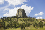 Devil's Tower Rises Above the Tree Lined Landscape Below Photographic Print by Stacy Gold