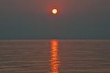 Sunset on Lake Malawi Sunset Above Lake Malawi Photographic Print by Karen Kasmauski