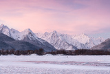 Pink Dawn over Snowy Mountains with a Frozen River in the Foreground Photographic Print by Jak Wonderly