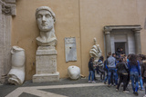 Tourists Line Up at the Entrance of the Capitoline Museum Next to a Bust of Constantine Photographic Print by Will Van Overbeek