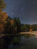 Bright Star Sirius, and Constellations Orion and Taurus over the Merced River, in Moonlight Photographic Print by Babak Tafreshi