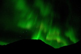 The Aurora Borealis with Ursa Major Filling the Sky over Mountain Ridges Photographic Print by Bob Smith