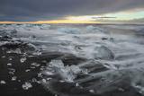 Crystal Clear Icebergs and Volcanic Sand Beach on the Atlantic Shore Near Jokulsarlon Glacier Lake Photographic Print by Babak Tafreshi