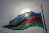 The Sun Shines Through the Azerbaijan National Flag Photographic Print by Will Van Overbeek