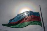 The Sun Shines Through the Azerbaijan National Flag Photographic Print by Will Van Overbeek