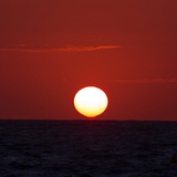The Sun Sinks into the Atlantic Ocean, Off the Coast of Normandy, France Photographic Print by Babak Tafreshi