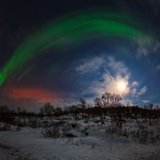 View of the Aurora Borealis, Northern Lights, Moon, and Scattered Light Pollution Photographic Print by Babak Tafreshi