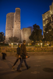 Pedestrians Walk Near the Maiden Tower at Night Photographic Print by Will Van Overbeek