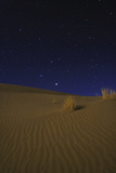 Night Sky Above Moonlit Desert Sand Dunes. Saturn, the Brightest, Appears in the Constellation Leo Photographic Print by Babak Tafreshi