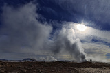 Steam from Geysers in Myvatn Geothermal Area, Northern Iceland. a Volcano Is on the Horizon Photographic Print by Babak Tafreshi