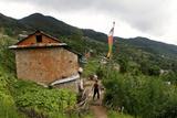 A Man Walks Through the Small Village of Tarebir, About an Hour Walk Up from Kathmandu Photographic Print by Jill Schneider