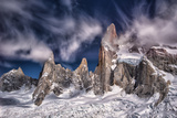 A Scenic Patagonia Landscape with the Rugged Andes Mountains Jutting from a Blanket of Snow Fotografisk tryk