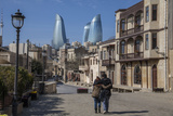 A Couple Strolls Through Baku's Old City under the Modern Flame Towers Photographic Print by Will Van Overbeek