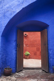 A Colorful Blue Wall with a Doorway to a Red Hallway Inside the Santa Catalina Monastery Photographic Print by Gabby Salazar