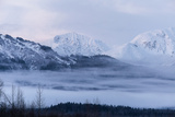 Snow-Capped Mountains and Low-Lying Clouds Near Haines, Alaska Photographic Print by Jak Wonderly