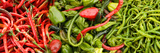 Close-Up of Green and Red Chili Peppers at Market Stall Photographic Print by Panoramic Images