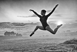A Ballerina Dances Beneath a Cloud-Filled Sky Photographic Print by Kike Calvo