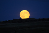 Moonrise over a Silhouetted Landscape Photographic Print by Michael Forsberg
