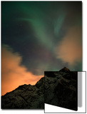 An Aurora Borealis and the Big Dipper Constellation Above a Mountain Peak Posters by Sergio Pitamitz
