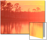 A Colorful and Fiery Sunset over the Chesapeake Bay and Coastal Forests Print by Robbie George